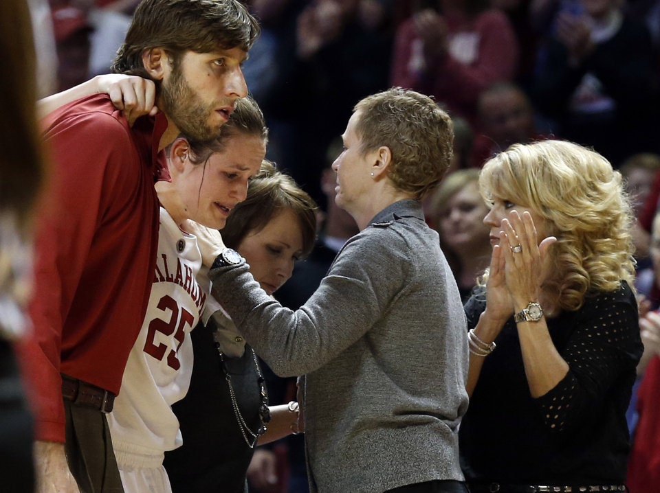 Photo - Whitney Hand is helped off the court after an injury by strength coach Jozsef Szendrei and trainer Carolyn Loon as she passes assistant coach Jan Ross and head coach Sherri Coale as the University of Oklahoma Sooners (OU) play the North Texas Mean Green in NCAA, women's college basketball at The Lloyd Noble Center on Thursday, Dec. 6, 2012  in Norman, Okla. Photo by Steve Sisney, The Oklahoman