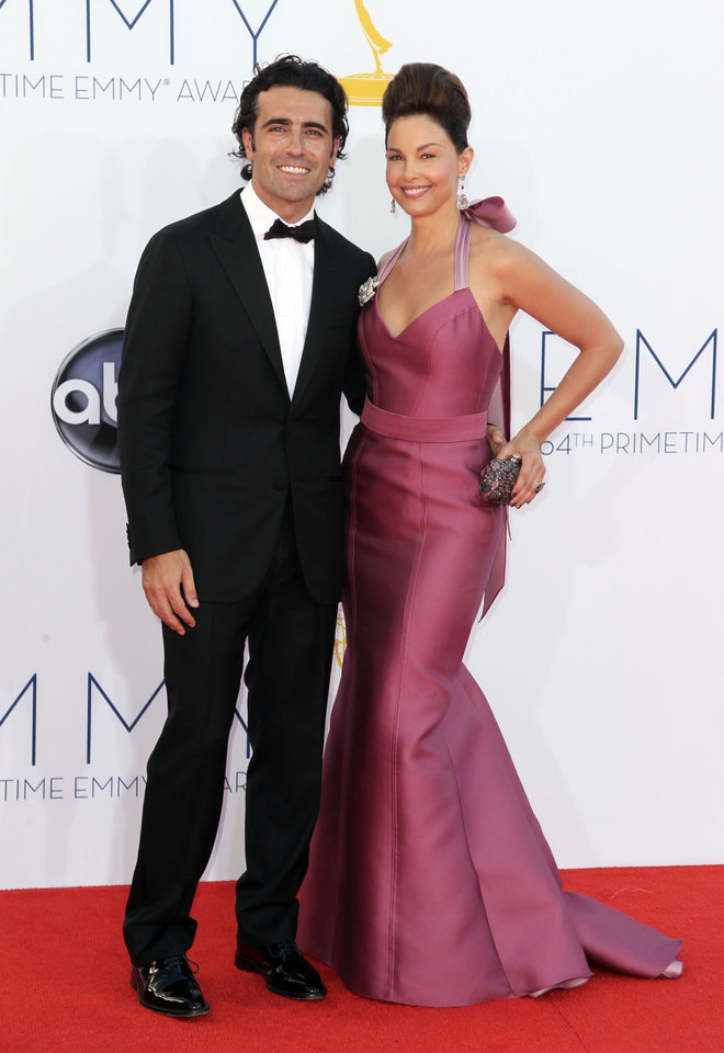 FILE - In this Sept. 23, 2012 file photo, actress Ashley Judd, right, and her husband, Dario Franchitti, arrives at the 64th Primetime Emmy Awards at the Nokia Theatre, in Los Angeles. Judd\'s spokeswoman confirmed a Tuesday, Jan. 29, 2013, report from People that the 44-year-old actress and 39-year-old Scottish race car driver are ending their marriage. (Photo by Matt Sayles/Invision/AP, File)