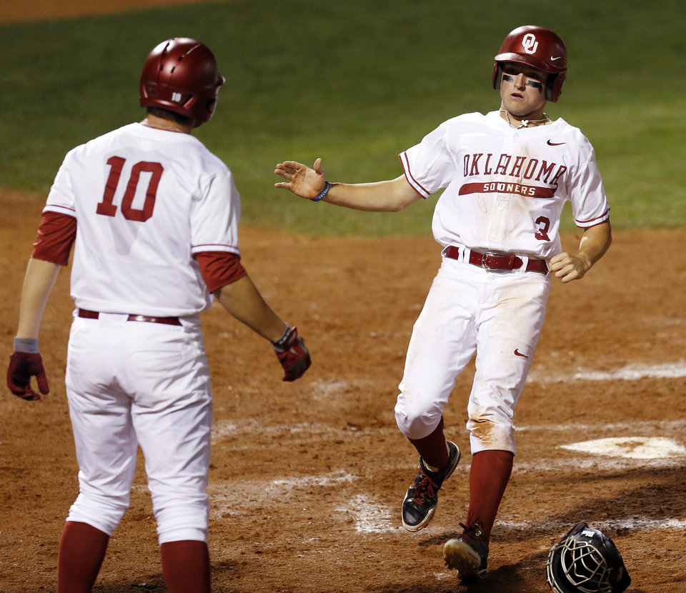 OU\'s Craig Aikin (3) celebrates with Niko Buentello (10) after the pair scored in the fourth inning during a Bedlam college baseball game between Oklahoma and Oklahoma State in the Big 12 baseball tournament at the Chickasaw Bricktown Ballpark in Oklahoma City, Friday, May 23, 2014. Photo by Nate Billings, The Oklahoman