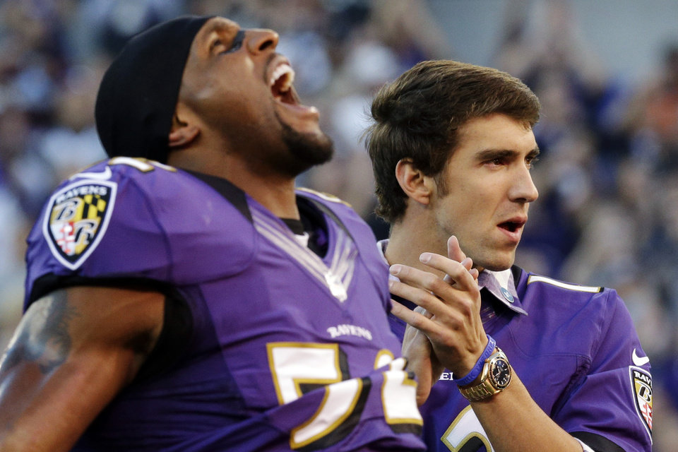 Photo -   Baltimore Ravens linebacker Ray Lewis, left, and Olympic swimmer Michael Phelps react as members of the Ravens take the field before an NFL football game against the Cincinnati Bengals in Baltimore, Monday, Sept. 10, 2012. (AP Photo/Patrick Semansky)