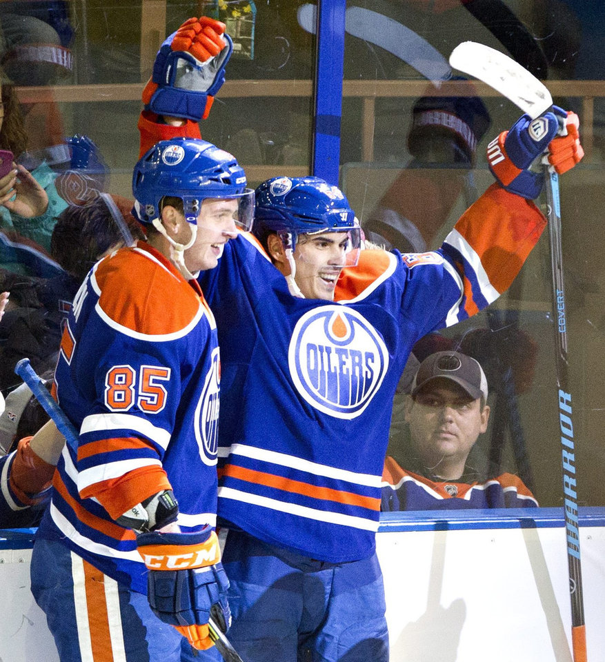Photo - Edmonton Oilers Martin Marincin (85) and Nail Yakupov (64) celebrate a goal against the Nashville Predators during second period NHL hockey action in Edmonton, Canada, Sunday, Jan. 26, 2014. (AP Photo/The Canadian Press, Jason Franson)