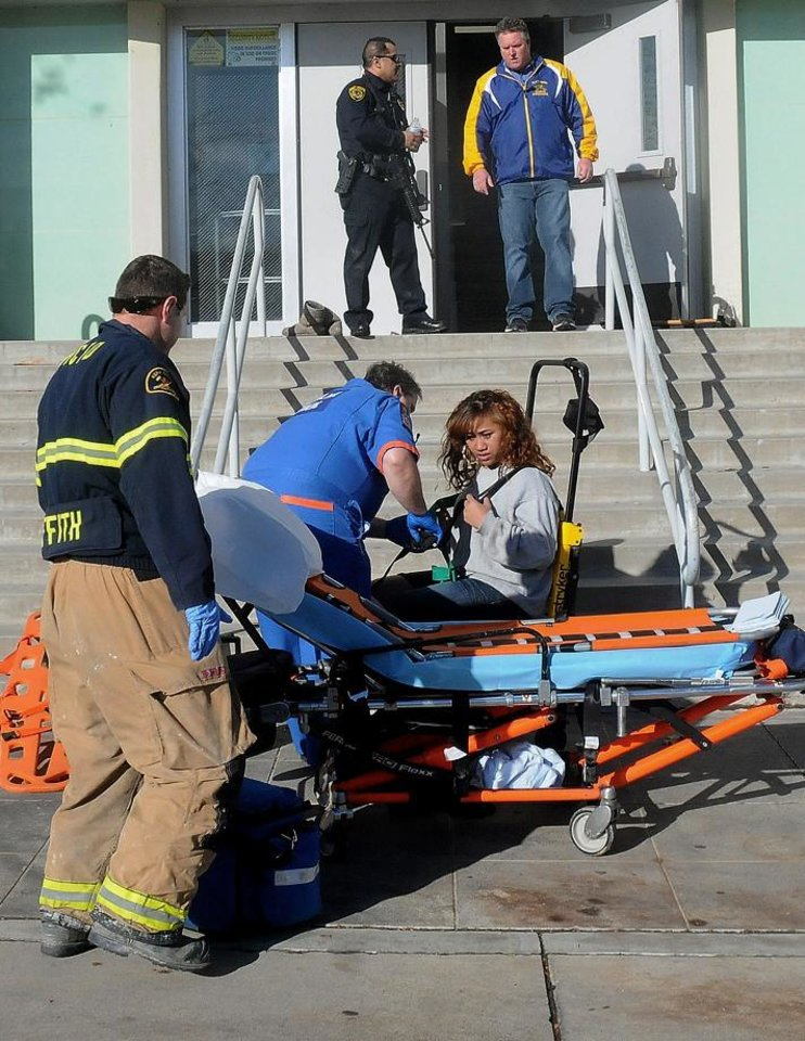 Photo - This image provided by the Taft Midway Driller/Doug Keeler shows paramedics assisting a student wounded during a shooting Thursday Jan. 10, 2013 at San Joaquin Valley high school in Taft, Calif. Authorities said a student was shot and wounded and another student was taken into custody. (AP Photo/Taft  Midway Driller, Doug Keeler) MANDATORY CREDIT