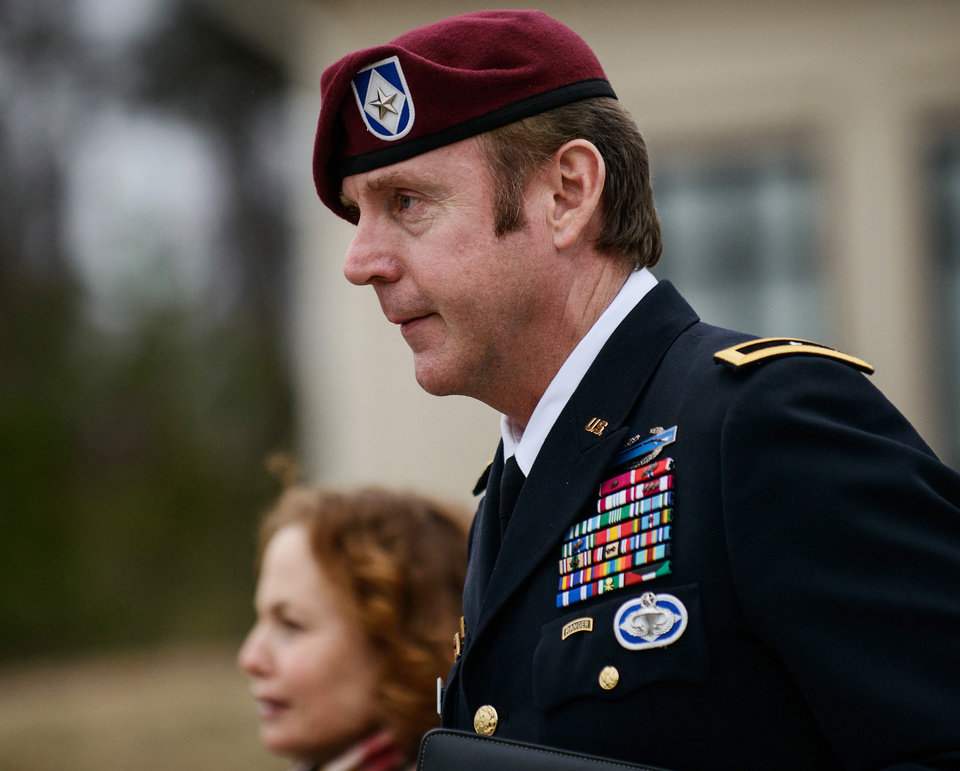Photo - FILE - In this March 4, 2014, file photo, Brig. Gen. Jeffrey Sinclair leaves the courthouse following a day of motions at Fort Bragg, N.C. A military judge declined Monday, March 10, 2014, to dismiss sexual assault charges against Sinclair after reviewing what he said was evidence that political considerations influenced the military's handling of the case. (AP Photo/The Fayetteville Observer, James Robinson, File)