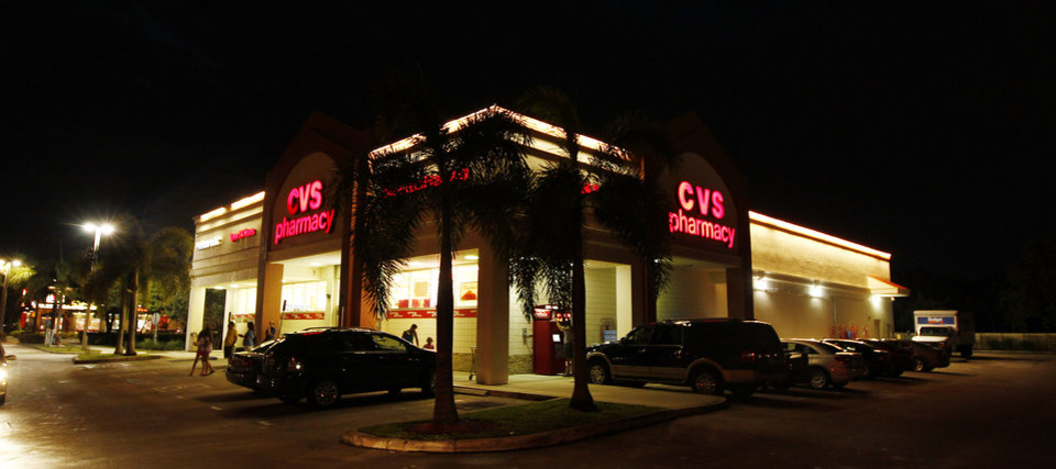 Photo -   In a July 17, 2012 photo, a CVS drug store is lit up in Doral, Fla. CVS Caremark said Tuesday Aug. 7, 2012, its second-quarter net income jumped more than 18 percent, as new business and an expansion of its pharmacy benefits management business pushed revenue higher. (AP Photo/J Pat Carter)