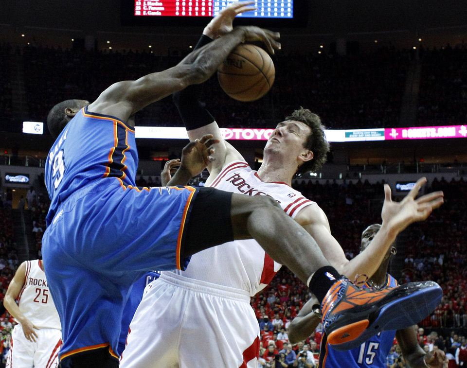 Photo - Oklahoma City's Serge Ibaka (9) defends against Houston's Omer Asik (3) during Game 4 in the first round of the NBA playoffs between the Oklahoma City Thunder and the Houston Rockets at the Toyota Center in Houston, Texas, Monday, April 29, 2013. Photo by Bryan Terry, The Oklahoman