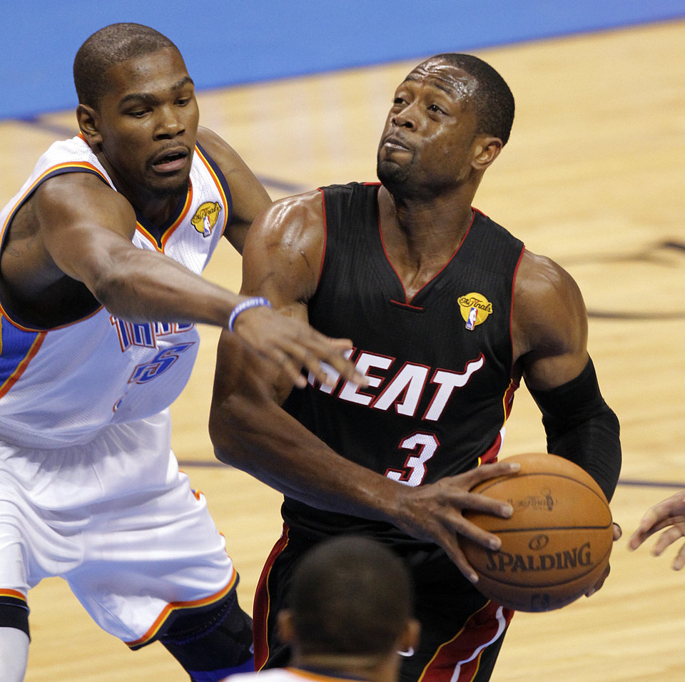 Oklahoma City's Kevin Durant (35) defends on Miami's Dwyane Wade (3) during Game 2 of the NBA Finals between the Oklahoma City Thunder and the Miami Heat at Chesapeake Energy Arena in Oklahoma City, Thursday, June 14, 2012. Photo by Chris Landsberger, The Oklahoman