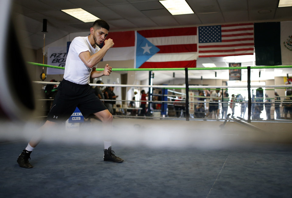 Photo -  Alex Saucedo works out at Azteca Boxing Gym in Oklahoma City on Thursday. Suacedo will be fighting in Oklahoma City on June 30 and a win could put him in line for a world-title bout. [PHOTO BY SARAH PHIPPS, THE OKLAHOMAN]