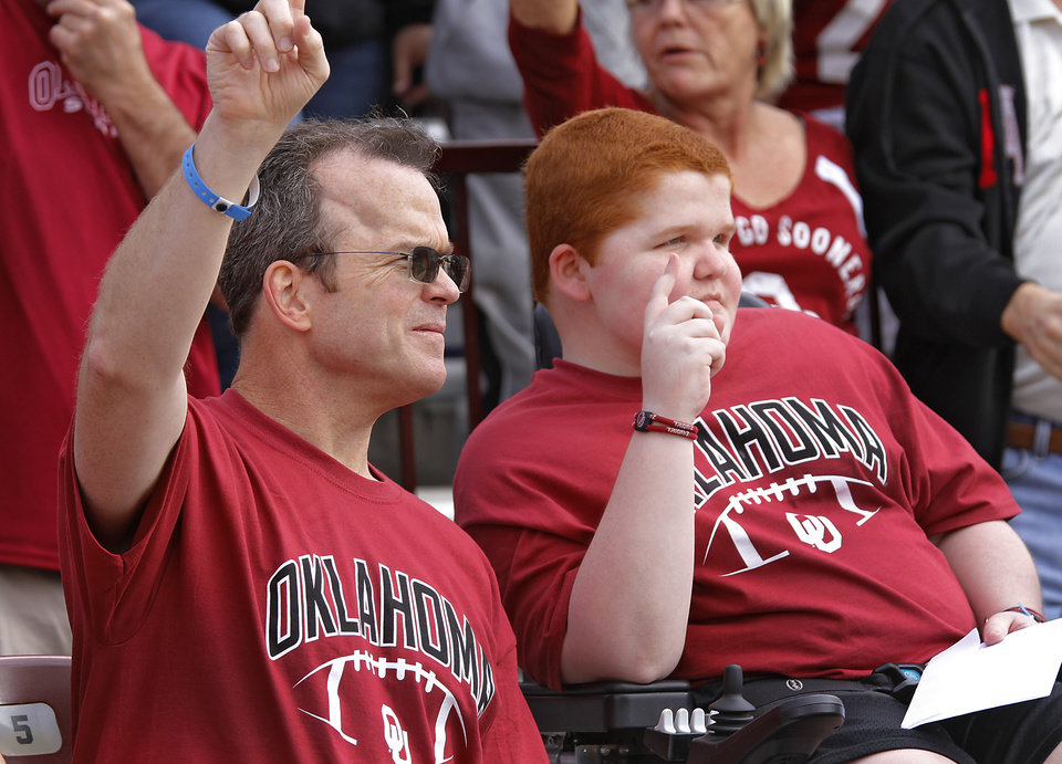 KEEGAN ERBST: Scott Erbst and his son Keegan watch the action on the field during the college football game between the University of Oklahoma Sooners (OU) and Baylor University Bears (BU) at Gaylord Family - Oklahoma Memorial Stadium on Saturday, Nov. 10, 2012, in Norman, Okla.  Photo by Chris Landsberger, The Oklahoman