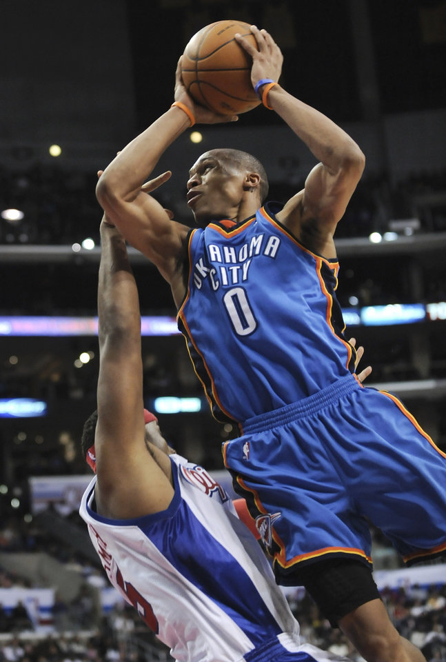 Photo - L.A. CLIPPERS: Oklahoma City Thunder guard Russell Westbrook (0) drives on Los Angeles Clippers forward Craig Smith in the second half of an NBA basketball game, Friday, March 5, 2010, in Los Angeles. The Thunder won 104-87. (AP Photo/Gus Ruelas) ORG XMIT: LAS108