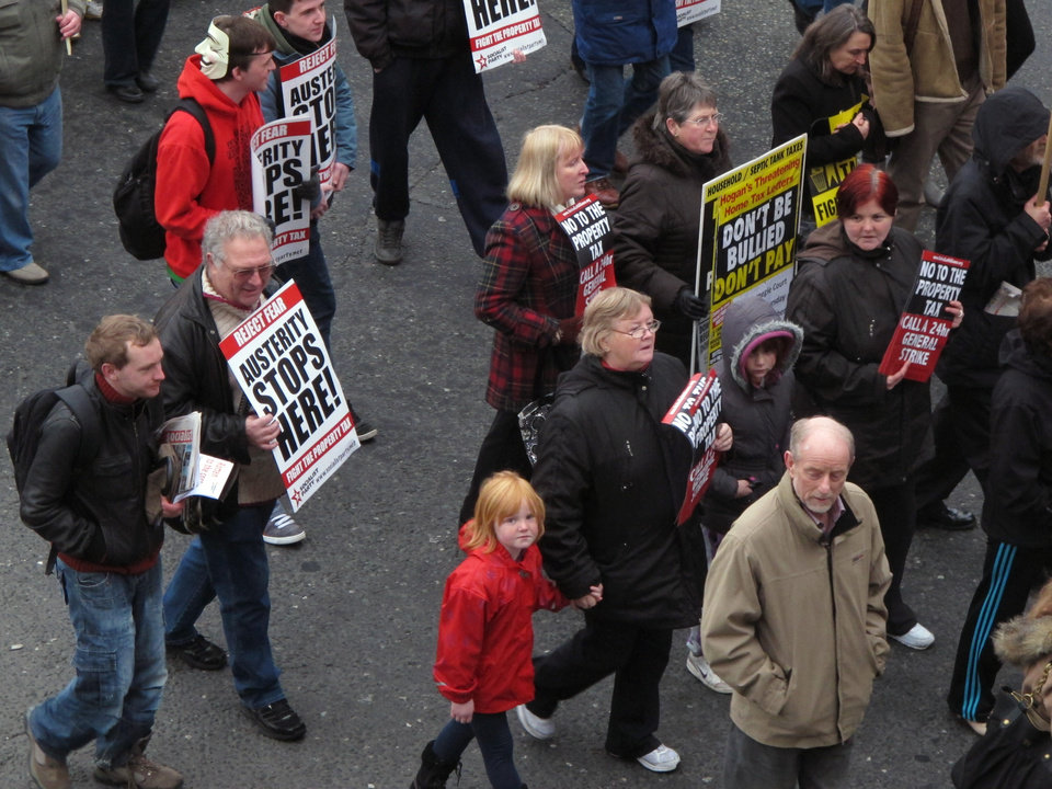 Photo -   Irish protesters march down Dublin's O'Connell street in a demonstration against a new round of budget cuts and tax rises Saturday, Nov. 24, 2012. The government says it will unveil Ireland's sixth straight austerity budget next month in hopes of reducing the country's 2013 deficit to 8.6 percent, still nearly triple the spending limit that eurozone members are supposed to observe. (AP Photo/Shawn Pogatchnik)