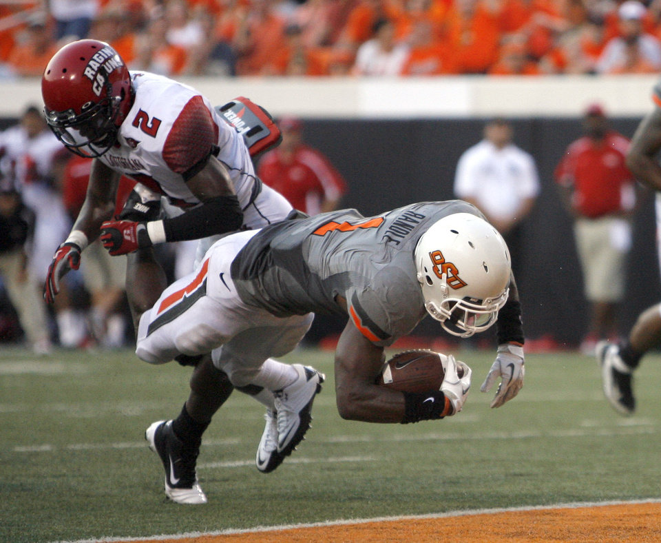 Photo - Oklahoma State's Joseph Randle scores a touchdown in front of Louisiana-Lafayette's Jemarlous Moten. Photo by Sarah Phipps, The Oklahoman