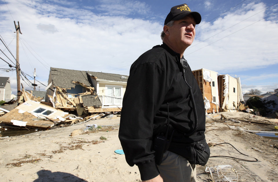 Photo -   Seaside Heights Police Chief Tom Boyd stands near destroyed homes on Rt. 35 north in Ortley Beach, N.J.. Wednesday, Oct. 31, 2012. (AP Photo/Star-Ledger, David Gard/POOL)