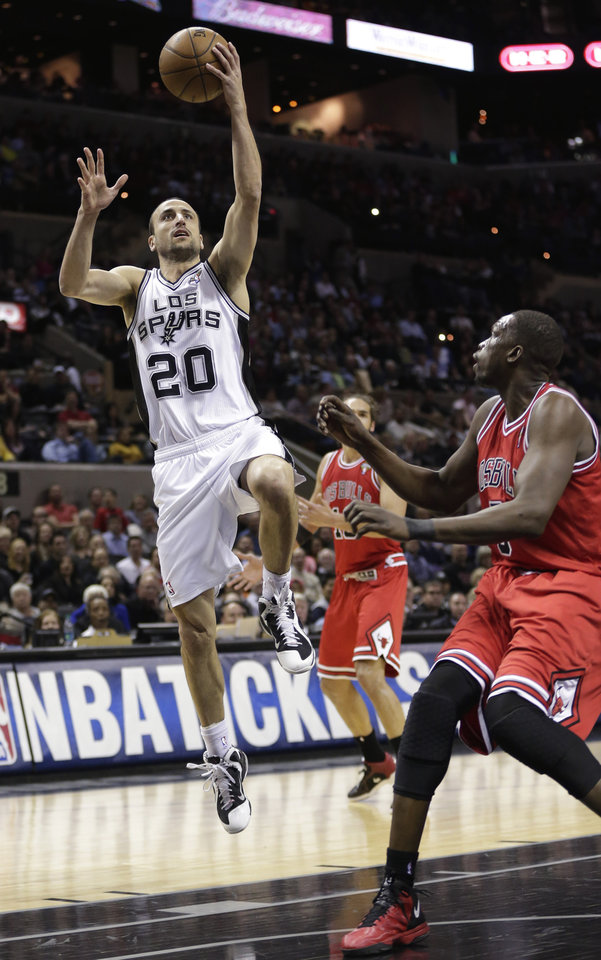 Photo - San Antonio Spurs' Manu Ginobili (20), of Argentina, shoots over Chicago Bulls' Luol Deng, right, during the first half of an NBA basketball game on Wednesday, March 6, 2013, in San Antonio. (AP Photo/Eric Gay)
