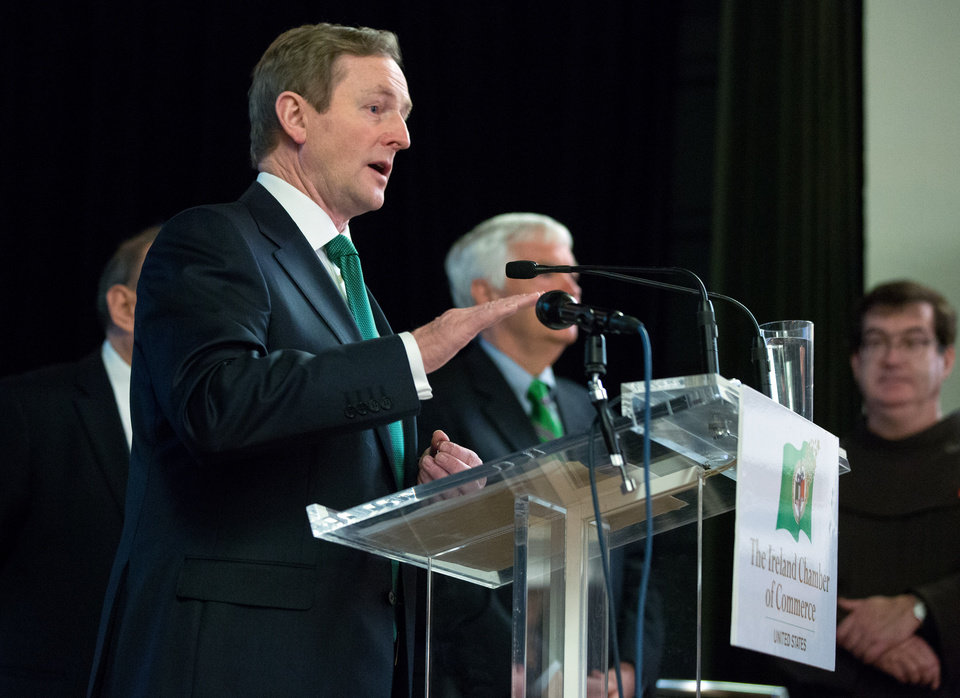Photo - Irish Prime Minister Enda Kenny addresses the 17th annual St. Patrick's Day Breakfast of the Ireland Chamber of Commerce, in New York,  Saturday, March 16, 2013. he Irish, their descendants and the Irish for the day prepared to don green and pay tribute to Hibernian heritage as a weekend of St. Patrick's Day celebrations was set from New York's Fifth Avenue to the Louisiana bayou to Dublin's Parnell Square.   (AP Photo/Richard Drew)