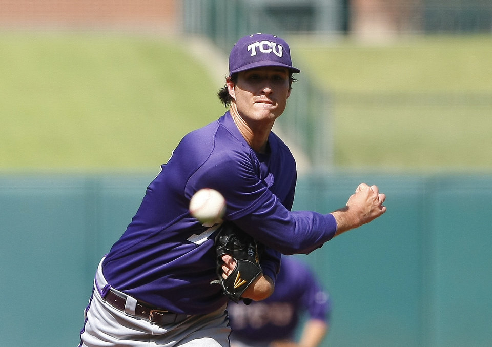 Photo - TCU starting pitcher Preston Morrison pitches in the first inning of a second-round game against West Virginia in the Big 12 conference NCAA college baseball tournament in Oklahoma City, Thursday, May 22, 2014. (AP Photo/Alonzo Adams)