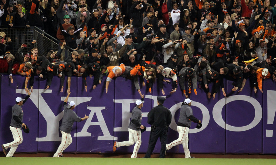 Photo -   The San Francisco Giants celebrate their 8-4 win over the San Diego Padres in a baseball game Saturday, Sept. 22, 2012, in San Francisco. The Giants captured the NL West title. (AP Photo/San Francisco Chronicle, Lance Iversen)