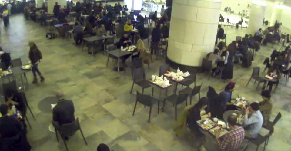 Photo - In this undated image made from a CCTV video released by Turkish police on Tuesday, Jan. 29, 2013, a woman identified by police as Sarai Sierra, 33, standing at center left, is seen at a shopping mall cafeteria in Istanbul, Turkey. Sierra has been missing since Jan. 21, when she was supposed to return to New York but was not on her flight back home. She arrived in Istanbul on Jan 7. (AP Photo)