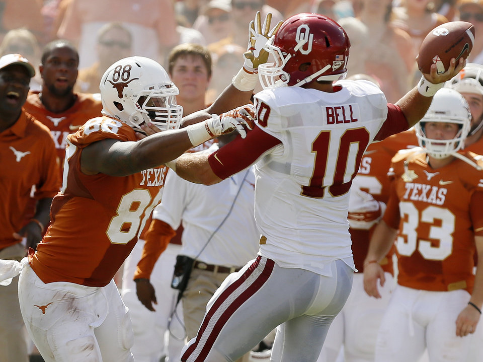 Photo - UT's Cedric Reed (88) pressures OU's Blake Bell (10) in the fourth quarter during the Red River Rivalry college football game between the University of Oklahoma Sooners and the University of Texas Longhorns at the Cotton Bowl Stadium in Dallas, Saturday, Oct. 12, 2013. UT won, 36-20. Photo by Nate Billings, The Oklahoman