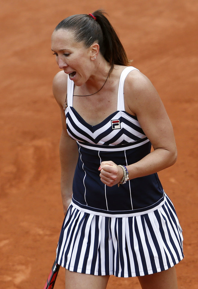 Photo - Serbia's Jelena Jankovic clenches her fist as she plays Japan's Kurumi Nara during the second round match of  the French Open tennis tournament at the Roland Garros stadium, in Paris, France, Thursday, May 29, 2014. Jankovic won 7-5, 6-0. (AP Photo/Darko Vojinovic)