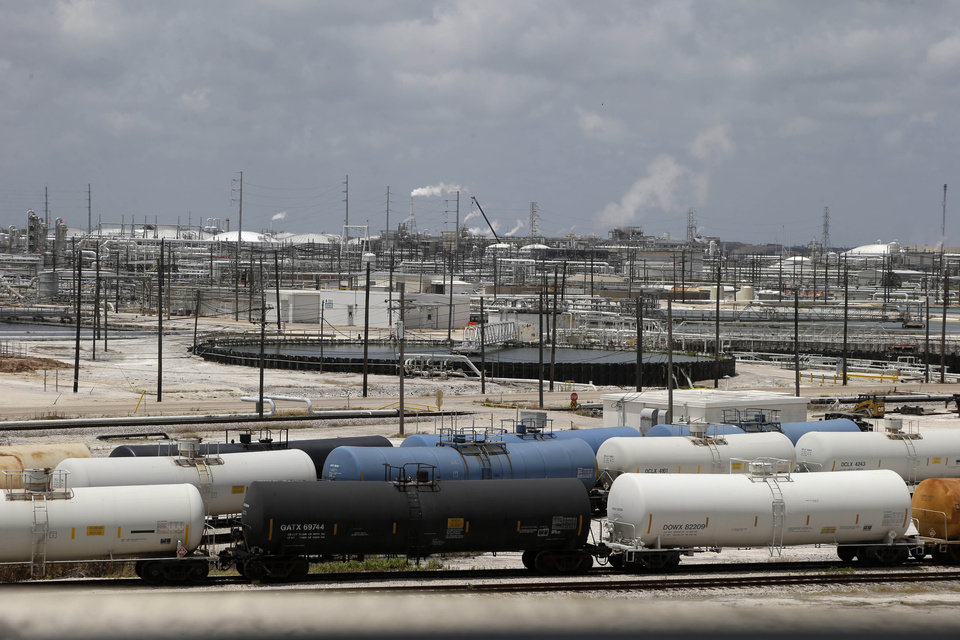 Photo - In this May 22, 2014 photo, railroad tanker cars line alongside a Dow Chemicals plant in Freeport, Texas. The plan from Dow Chemical and the Nature Conservancy calls for growing thick groves of trees to capture pollutants downwind from a chemical plant. (AP Photo/Pat Sullivan)