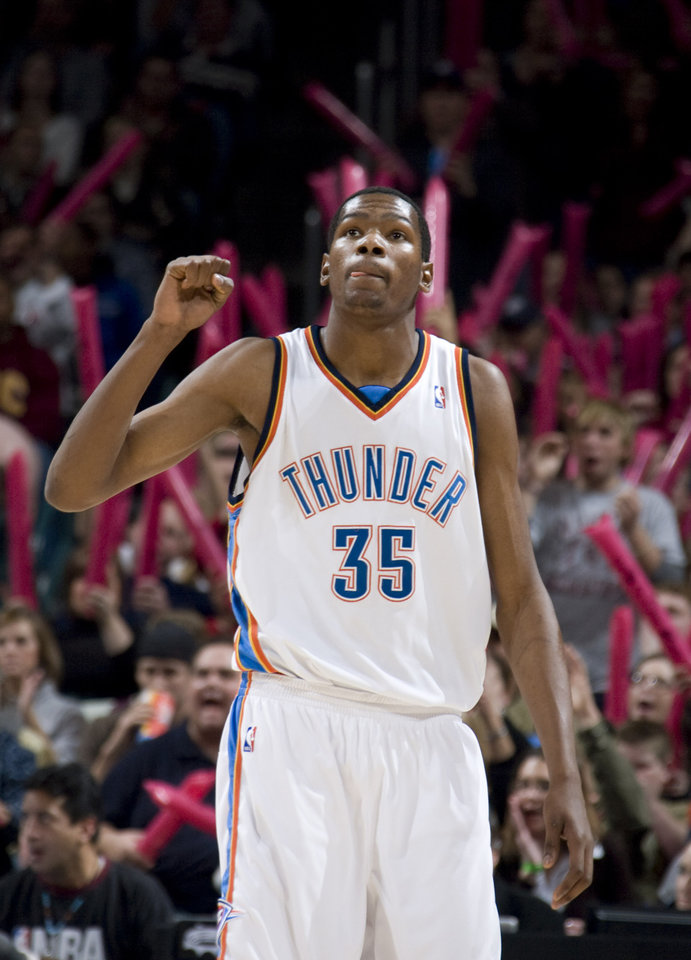 Photo - Oklahoma City's Kevin Durant (35) celebrates a Thunder score during the NBA basketball game between the Oklahoma City Thunder and the Los Angeles Clippers at the Ford Center in Oklahoma City, Tuesday, Dec. 16, 2008. PHOTO BY SARAH PHIPPS, THE OKLAHOMAN