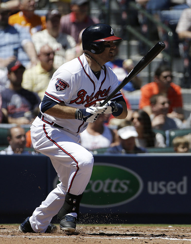 Photo - Atlanta Braves' Ryan Doumit singles to score teammate Chris Johnson in the fourth inning of a baseball game against the Miami Marlins, Wednesday, April 23, 2014, in Atlanta. (AP Photo/David Goldman)