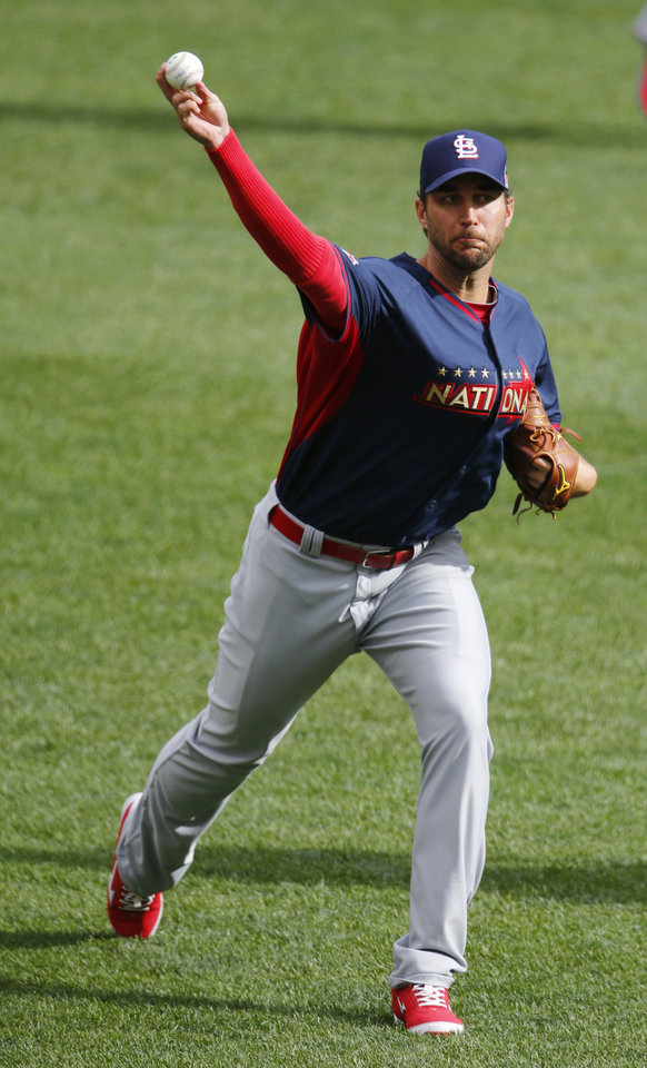 Photo - National League starting pitcher Adam Wainwright, of the St. Louis Cardinals, throws in the outfield during batting practice for the MLB All-Star baseball game, Monday, July 14, 2014, in Minneapolis. (AP Photo/Paul Sancya)