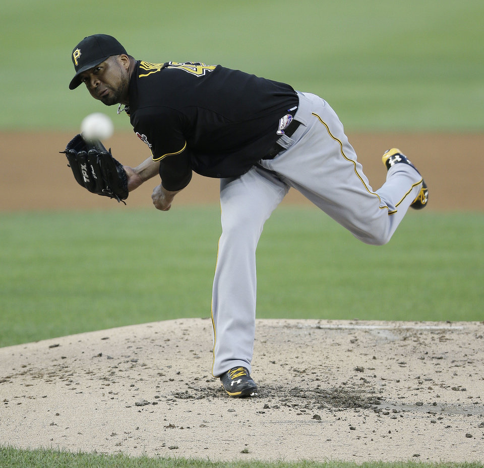 Pittsburgh Pirates starting pitcher Francisco Liriano throws to a Washington Nationals batter during the third inning of a baseball game at Nationals Park, Wednesday, July 24, 2013, in Washington. (AP Photo/Pablo Martinez Monsivais)