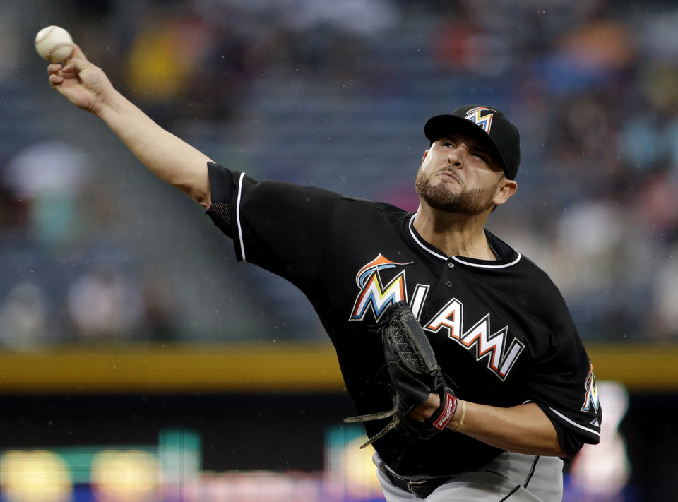 Miami Marlins starting pitcher Ricky Nolasco throws in the first inning of a baseball game against the Atlanta Braves, Wednesday, July 3, 2013, in Atlanta. (AP Photo/David Goldman)