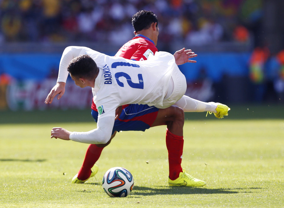 Photo - England's Ross Barkley, right, is fouled by Costa Rica's Giancarlo Gonzalez during the group D World Cup soccer match between Costa Rica and England at the Mineirao Stadium in Belo Horizonte, Brazil, Tuesday, June 24, 2014. (AP Photo/Jon Super)