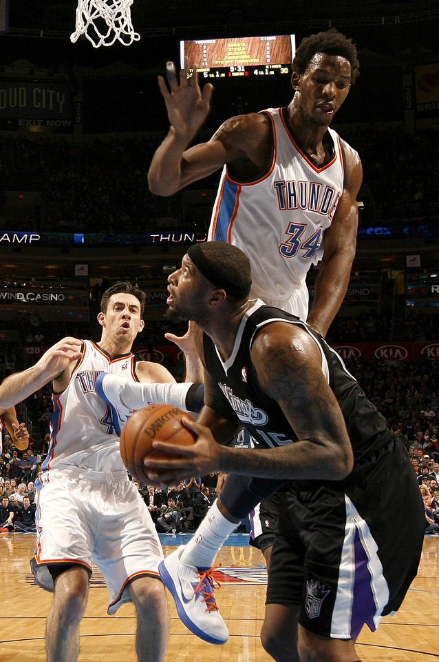 Oklahoma City\'s Hasheem Thabeet (34) defends Sacramento\'s DeMarcus Cousins (15) as Nick Collison (4) watches during an NBA basketball game between the Oklahoma City Thunder and the Sacramento Kings at Chesapeake Energy Arena in Oklahoma City, Friday, Dec. 14, 2012. Photo by Bryan Terry, The Oklahoman