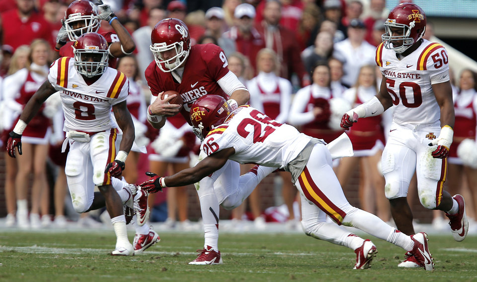 Oklahoma's Trevor Knight (9) runs past Iowa State's Deon Broomfield (26) during the college football game between the University of Oklahoma Sooners (OU) and the Iowa State University Cyclones (ISU) at Gaylord Family-Oklahoma Memorial Stadium in Norman, Okla. on Saturday, Nov. 16, 2013. Photo by Chris Landsberger, The Oklahoman