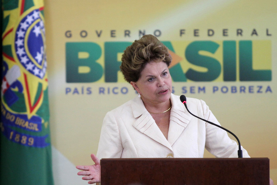 Photo -   Brazil's President Dilma Rousseff speaks during a ceremony where she announced an economic stimulus package at Planalto presidential palace in Brasilia, Brazil, Wednesday, June 27, 2012. The program announced by Rousseff focuses on a wide array of government purchases, from backhoes to motorcycles to military equipment. Rousseff says the government will use stimulus packages