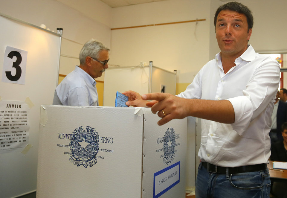 Photo - Italian Prime Minister Matteo Renzi casts his ballot, in Pontassieve, near Florence, Italy, Sunday, May 25, 2014. Italians are voting in elections to fill the 751-seat European Parliament which are taking place across the 28-nation EU May 22-25. (AP Photo/Fabio Muzzi)