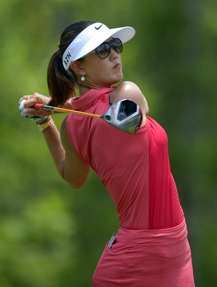 Photo - Michelle Wie hits her tee shot on the fourth hole in the final round of the Airbus LPGA Classic golf tournament at Magnolia Grove on Sunday, May 25, 2014, in Mobile, Ala. (AP Photo/G.M. Andrews)