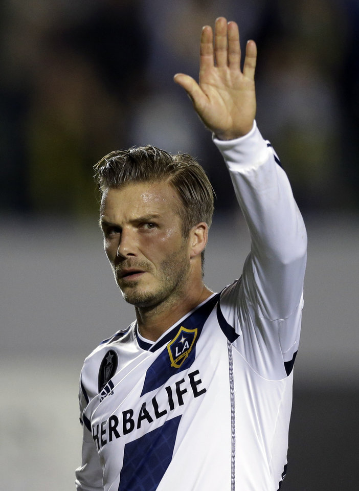 Photo -   Los Angeles Galaxy's David Beckham waves after as he leaves the field after their win against the Seattle Sounders during an MLS Western Conference finals soccer game in Carson, Calif., Sunday, Nov. 11, 2012. The Galaxy won 3-0. (AP Photo/Chris Carlson)