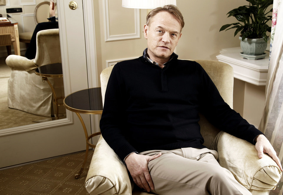 "In this Dec. 3, 2011 photo, actor Jared Harris, who portrays  Professor James Moriarty in the upcoming film ""Sherlock Holmes: A Game of Shadows"", poses for a portrait in Beverly Hills, Calif. Moriarty, who has loomed as the grandfather of all super-villains, is played with cool, quiet, chilling detachment by Jared Harris.  (AP Photo/Matt Sayles) ORG XMIT: NYET150"