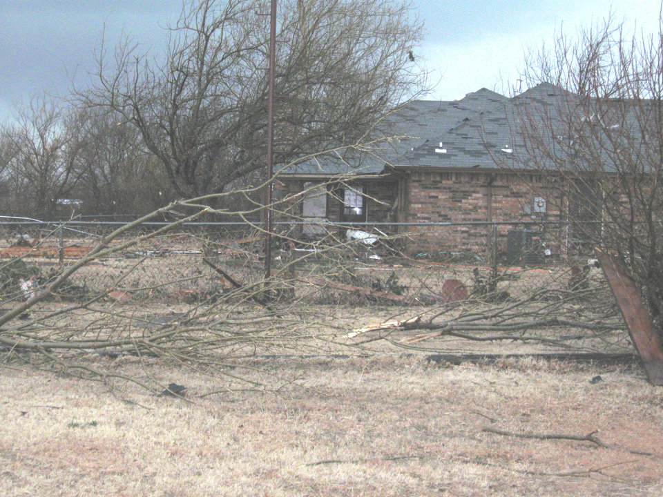 Photo - TORNADO / STORM DAMAGE: Several trees were toppled in the Big Cedar housing addition. PHOTO BY JOHN A. WILLIAMS, THE OKLAHOMAN ORG XMIT: 0902111549219521