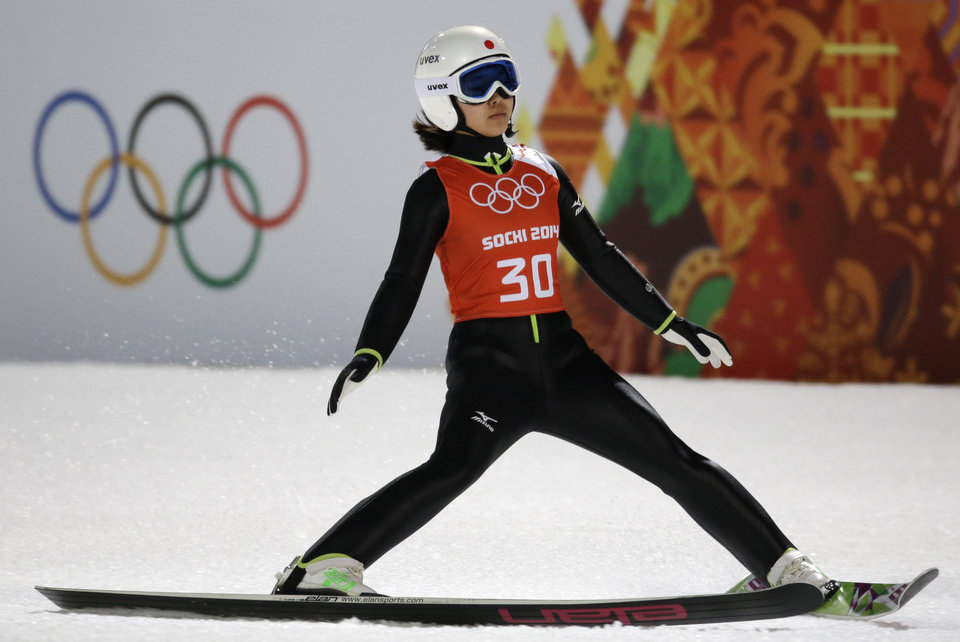 Photo - Japan's Sara Takanashi slows down in the finish area after an attempt during a women's normal hill ski jumping training at the 2014 Winter Olympics, Monday, Feb. 10, 2014, in Krasnaya Polyana, Russia. (AP Photo/Gregorio Borgia)