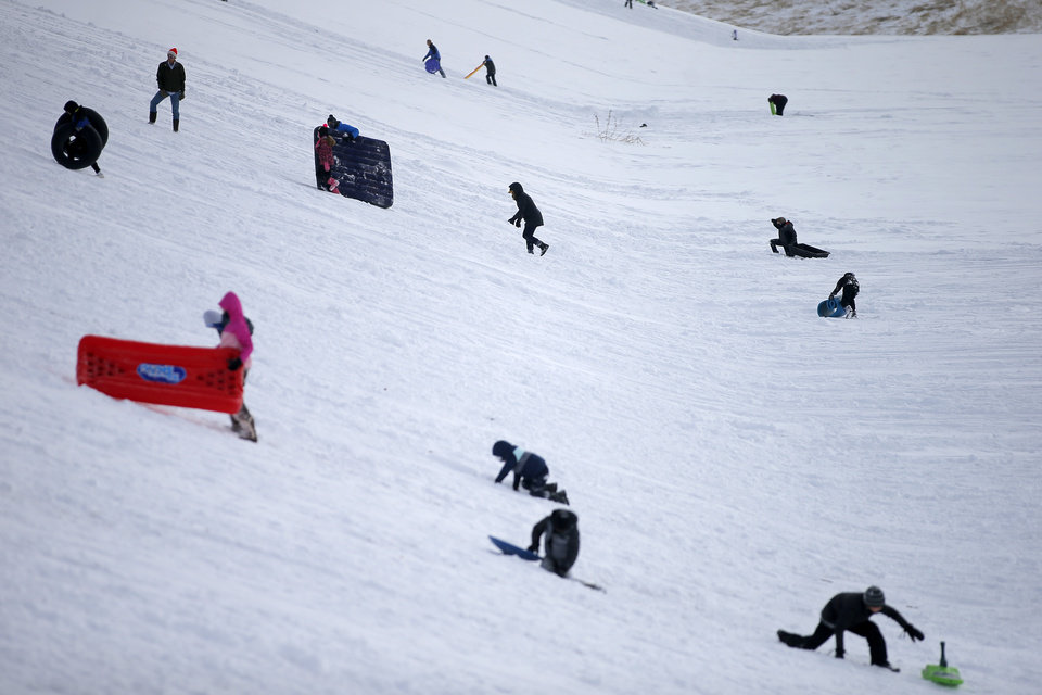 Photo - Sledders race up and down a hill along W Hefner Road in Oklahoma City after a winter storm dropped another layer of snow in Oklahoma City, Wednesday, Feb. 17, 2021. [Bryan Terry/The Oklahoman]