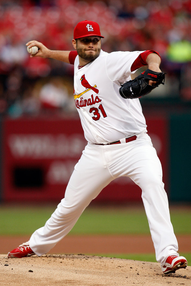 Photo - St. Louis Cardinals starting pitcher Lance Lynn  throws during the first inning of a baseball game against the Atlanta Braves Friday, May 16, 2014, in St. Louis. (AP Photo/Scott Kane)