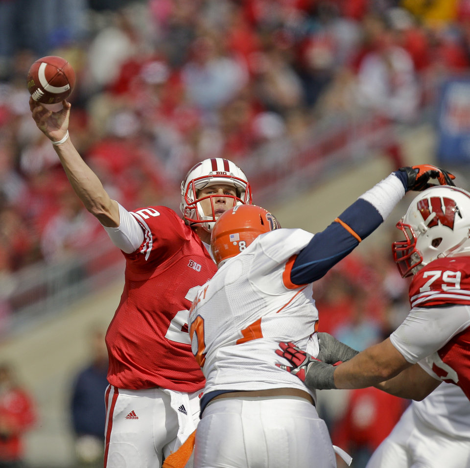 Photo -   Wisconsin quarterback Joel Stave, left, throws over UTEP defensive lineman Marcus Bagley during the second half of an NCAA college football game Saturday, Sept. 22, 2012, in Madison, Wis. Stave passed for 210-yards in Wisconsin's 37-26 win. (AP Photo/Andy Manis)