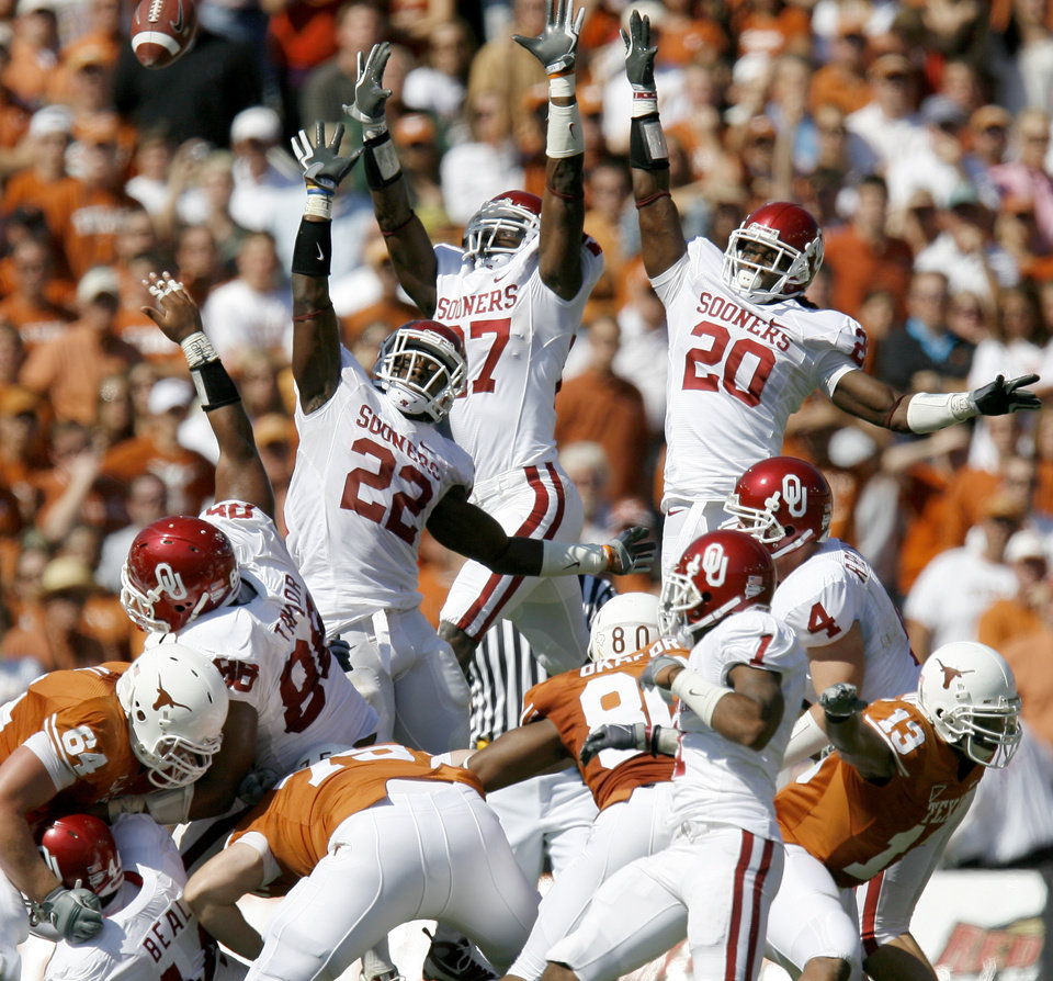 Photo - Members of the OU team try to block a field goal during the Red River Rivalry college football game between the University of Oklahoma Sooners (OU) and the University of Texas Longhorns (UT) at the Cotton Bowl in Dallas, Texas, Saturday, Oct. 17, 2009. Photo by Bryan Terry, The Oklahoman