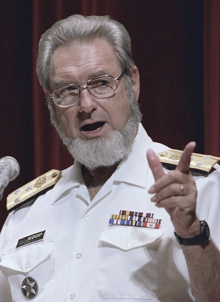 Photo - FILE - In this Sept. 14, 1988 file photo, U.S. Surgeon General C. Everett Koop speaks in Philadelphia. Koop, who raised the profile of the surgeon general by riveting America's attention on the then-emerging disease known as AIDS and by railing against smoking, died Monday, Feb. 25, 2013, in Hanover, N.H. He was 96. (AP Photo/Robert J. Gurecki, File)