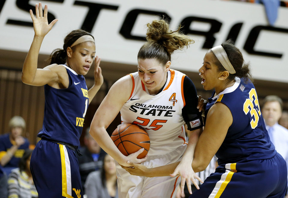 Oklahoma State's Lindsey Keller (25) fights for control of the ball between West Virginia's Christal Caldwell (1) and Ayana Dunning (33) during a women's college basketball game between Oklahoma State and West Virginia at Gallagher-Iba Arena in Stillwater, Okla.,  Tuesday, Jan. 29, 2013. Photo by Bryan Terry, The Oklahoman