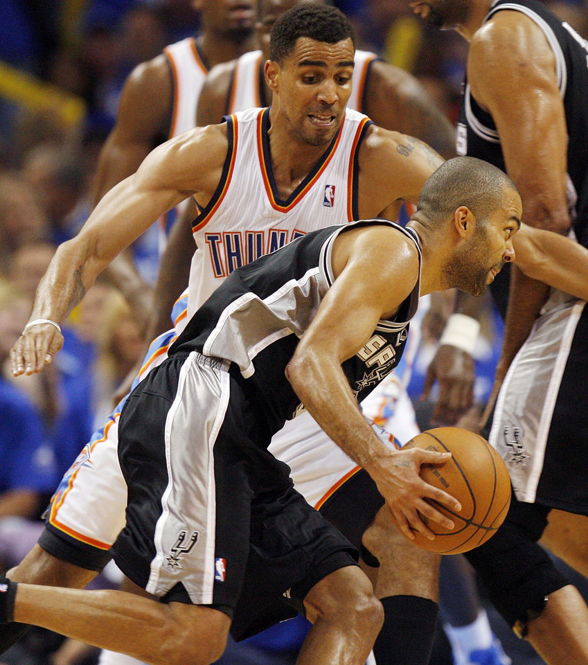 Photo - Oklahoma City's Thabo Sefolosha (2) defends San Antonio's Tony Parker (9) during Game 3 of the Western Conference Finals between the Oklahoma City Thunder and the San Antonio Spurs in the NBA playoffs at the Chesapeake Energy Arena in Oklahoma City, Thursday, May 31, 2012. Oklahoma City won, 102-82. Photo by Nate Billings, The Oklahoman