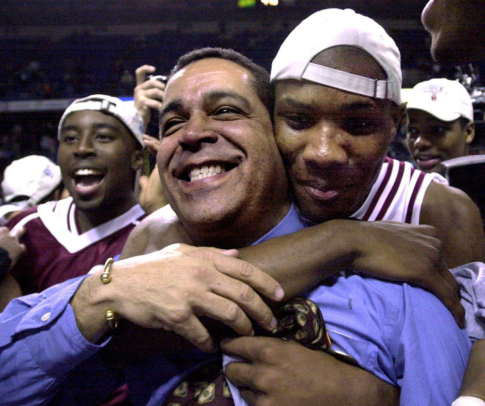 Photo - Daryan Selvy hugs coach Kelvin Sampson  after the OU Sooners beat Texas 54 to 45 in the BIG 12 tournament championship college basketball game in Kansas City.  Staff photo by Bryan Terry