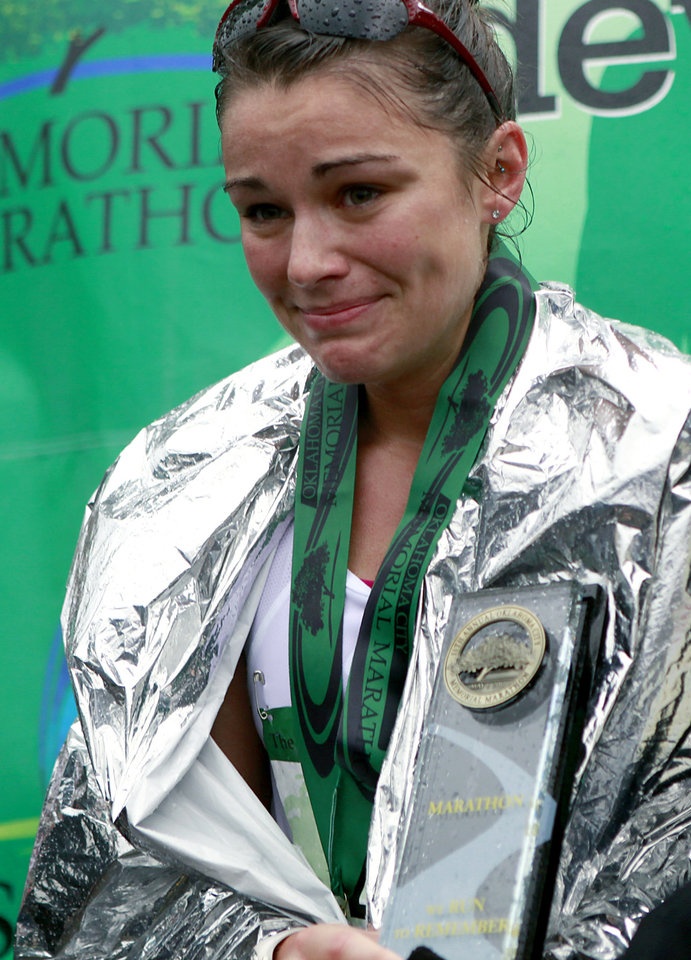 Photo - Alaina Zanin reacts as she is presented with a trophy for winning the 11th Annual Oklahoma City Memorial Marathon in Oklahoma City on Sunday, May 1, 2011. Photo by John Clanton, The Oklahoman