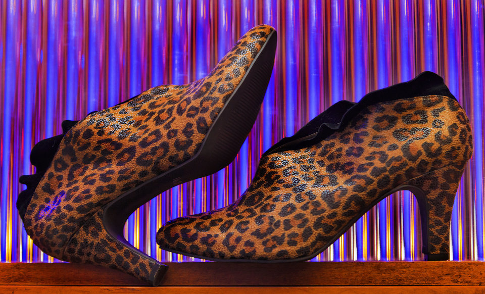 Photo - These leopard-print booties are from the shoe selection at Nearly New in Oklahoma City. Nearly New has a large selection of used formals, wedding gowns and men's and women's separates and accessories. Photo by Chris Landsberger, The Oklahoman.  CHRIS LANDSBERGER