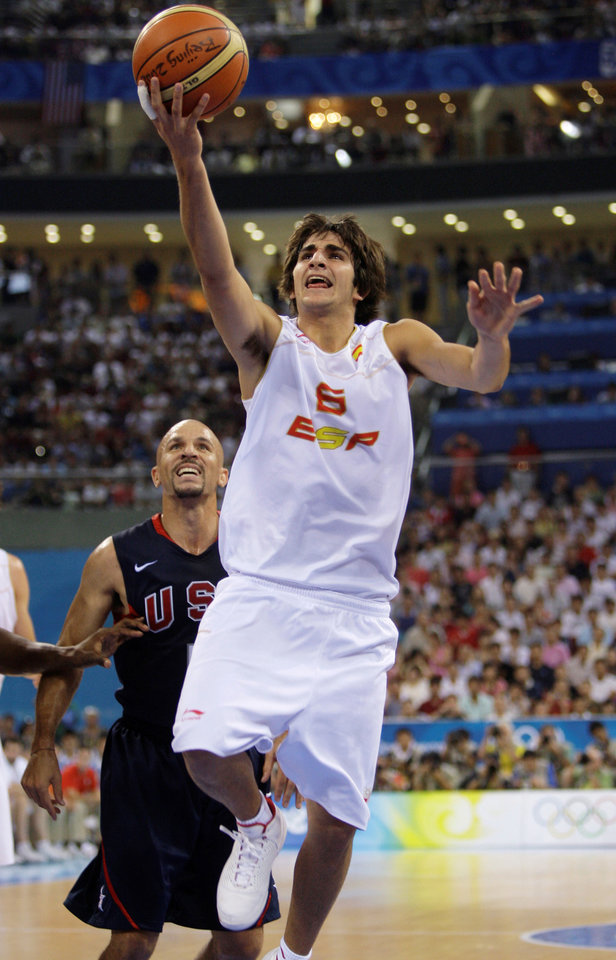 In this Aug. 24, 2008, file photo,  USA's Jason Kidd, left, watches as Spain's Ricky Rubio scores during the men's gold medal basketball game at the Beijing 2008 Olympics in Beijing. Rubio is a top prospect in the upcoming NBA Draft. (AP Photo/Dusan Vranic)